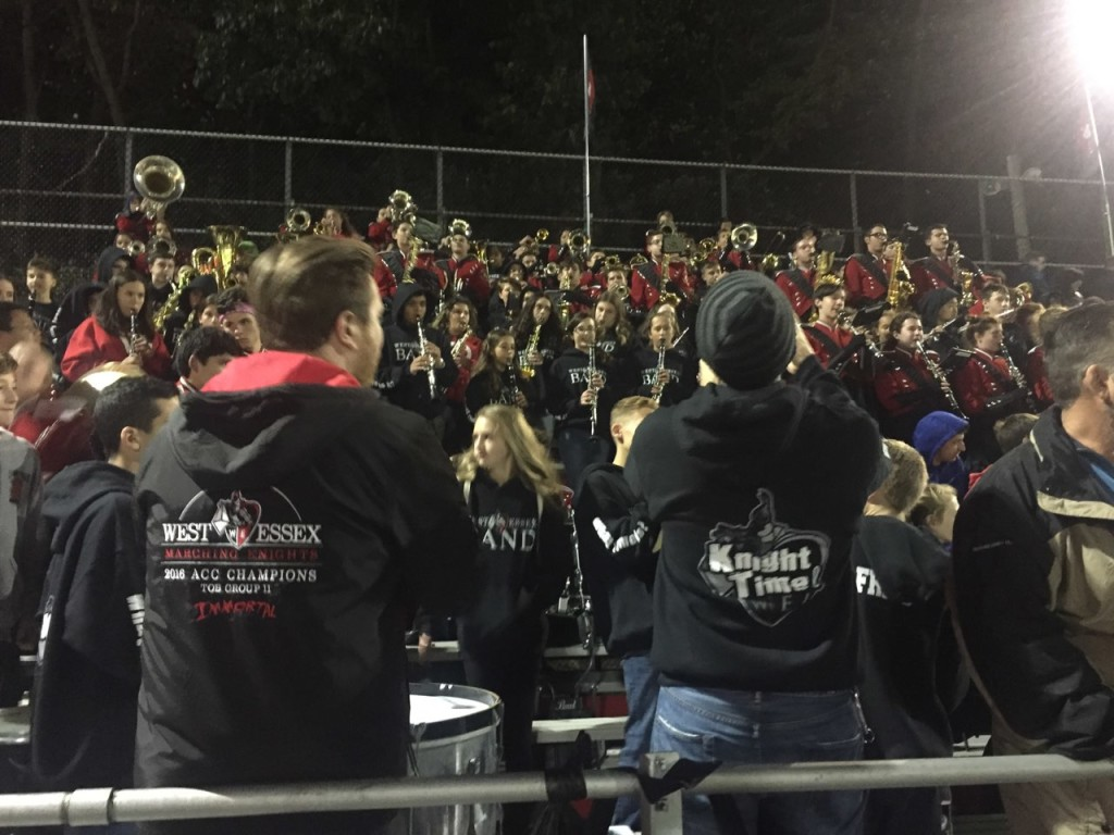 Mr. Fabrizio and Mr. Fitzke look on as current and future Marching Knights play from the stands