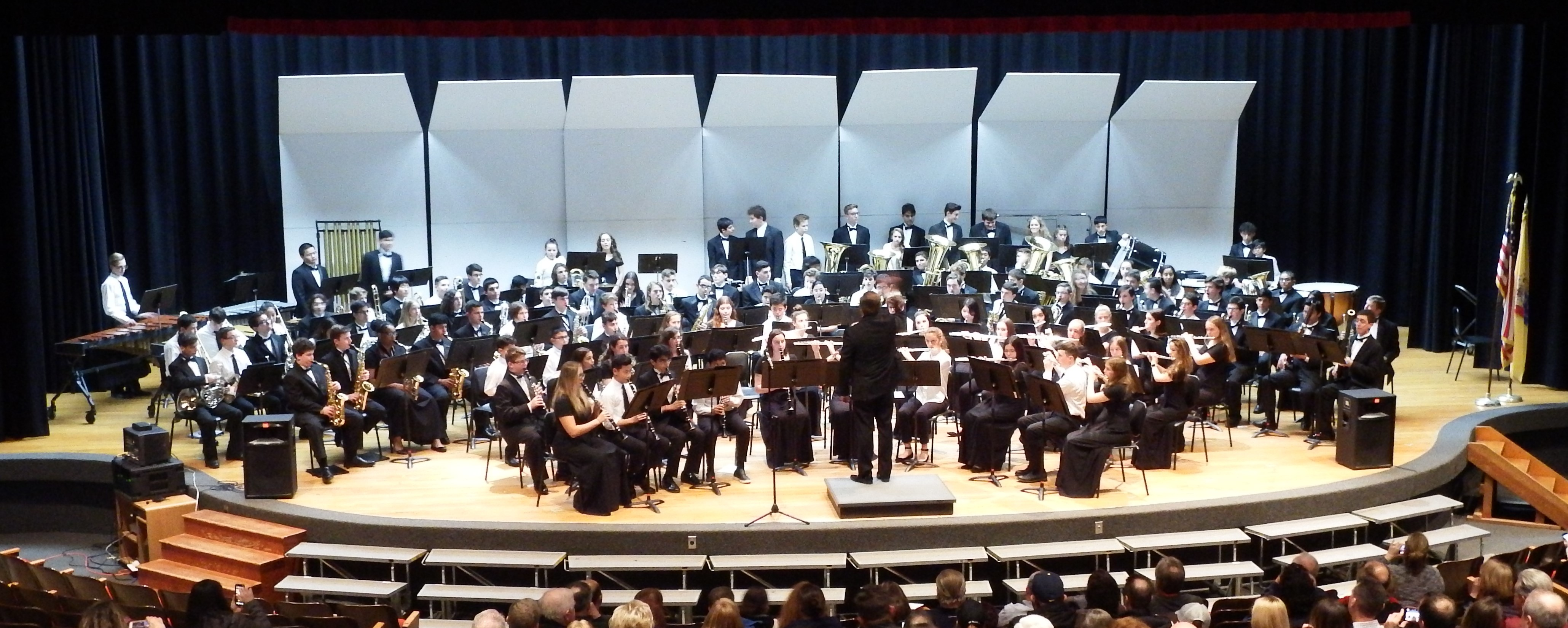 More than 130 musicians filled the stage as 8th Grade Band Students joined the High School musicians for a special combined performance!